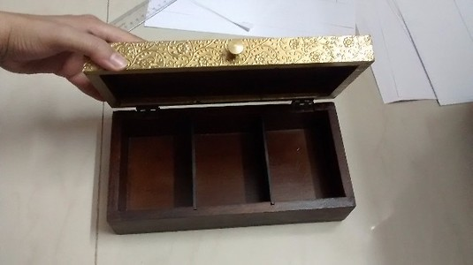 Wooden box with brass top