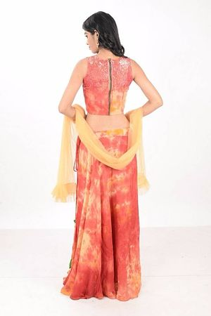 Tie-dyed sequinned crop top with tasseled skirt style lehnga and frill dupatta embellished with sequins