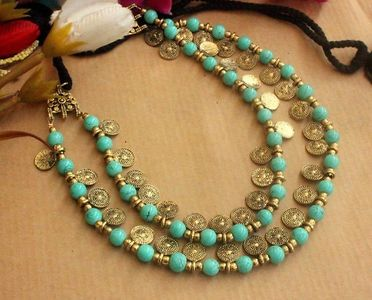 Multilayered beaded coin necklace two layers.
