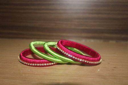 Green and pink silk thread bangles