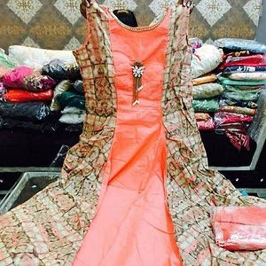 Beautiful orange fully stitched gown with leggin and dupatta