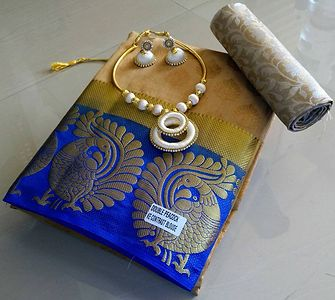 Double Peacock Embossed Tussar Saree