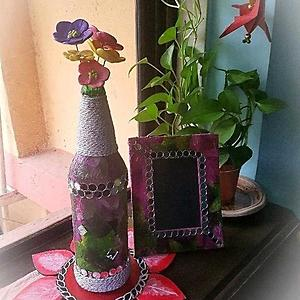 Vase with clay flowers and photo frame