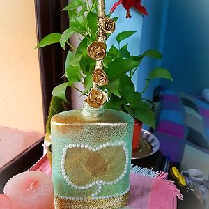 Upcycled vase with Golden clay flowers