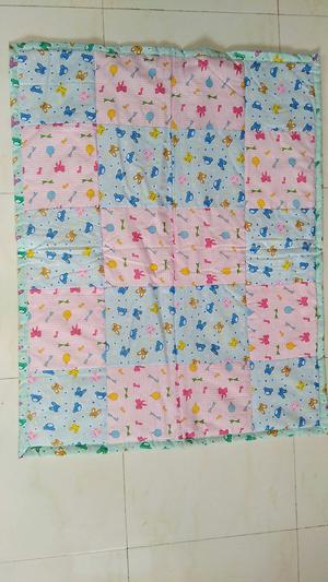 Pink and blue nursery print quilt
