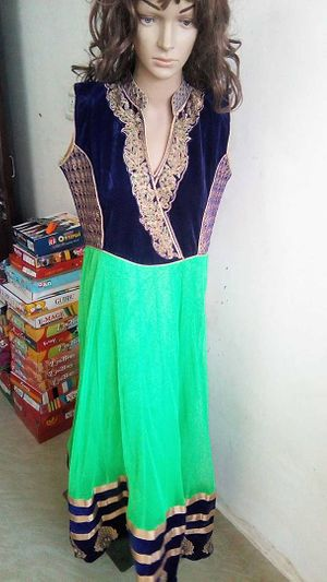 partywear heavy suite with satin salwar &net duppata.
