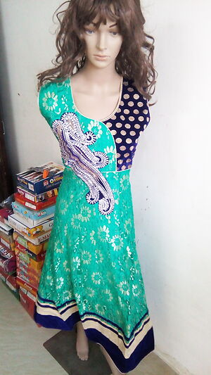 partywear heavy suits with satin salwar & net duppata.