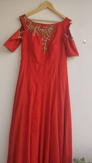 Long frock with zardosi work and stitched with kalews
