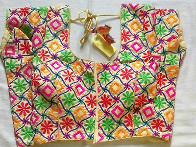 multi coloured stitched blouse