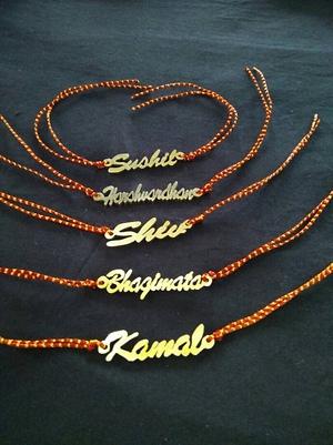 Brass Name Rakhis