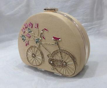 presenting my famous handwork cycle clutch on a new half round frame