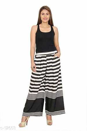 Trending Palazzos Fabric: Rayon  Waist Size:  M - 38in, L - 40in, XL - 42in, XXL - 44in  Product Details:Rayon Palazzo with Both Side Pockets and elasticated band and dori waistline to adjust the fit