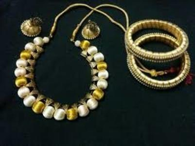 Golden and white necklace with antique beads and bangles