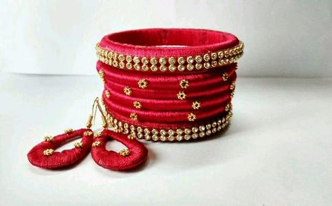 Red colour silk thread bangles made with gold colour flower work