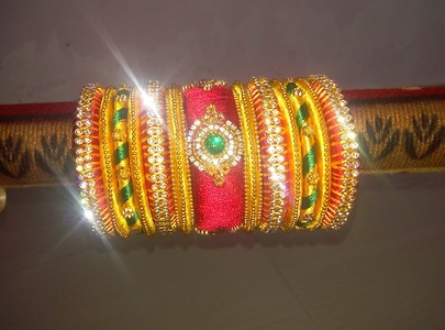 red and yellow silk thread bangles