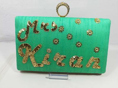 Customized name clutches