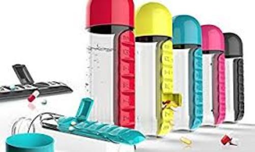 Water bottle with pills section