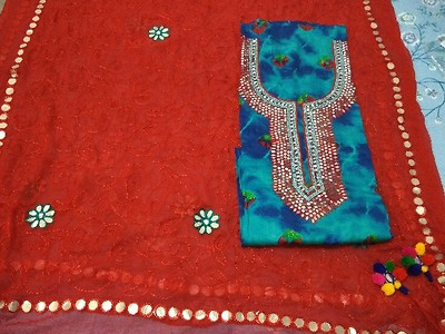 Designer blue with heavy mirror and stone work on neckline with full work duppata with latkans and Red cotton bottom