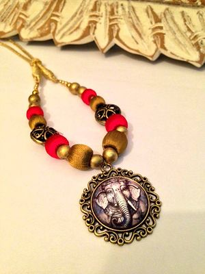 Dull gold and red fusion necklace with Ganesha pendant