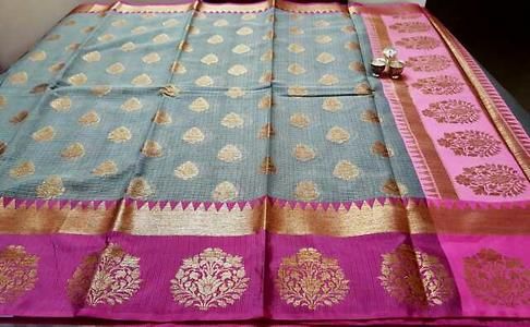 Most awaited saree from our buyers.  Restocked on high public demand.  Zari kota saree with weavings  Dark grey with wine contrast border. Brocade blouse.
