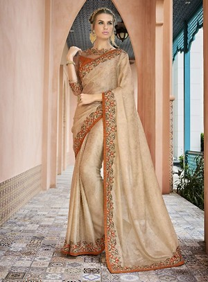 Triveni Beige Colored Border Worked Georgette Jacquard Partywear Saree TSN1803