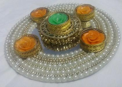 aarti dish with flower wax