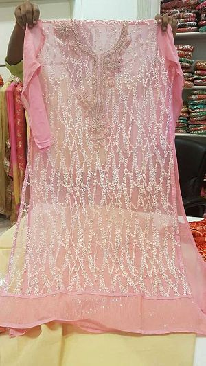 One of the beautiful  suit Front chinese imported fabric Back pure gorgett Pure chiffon dupatta Pure Shantoon  bottom