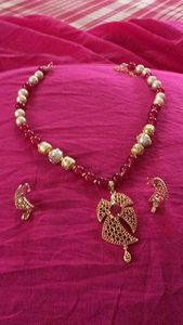 Beautiful white moti and maroon moti with Ruby n golden pendant set with earings